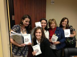 "Some of the Marketwave team, after reading and discussing ""The Art of Client Service."""